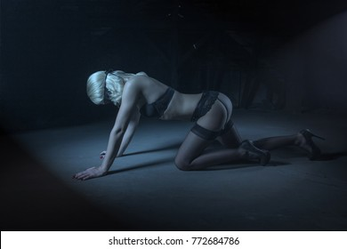 Sexy sensual passionate woman in underwear and blindfold posing on floor at night