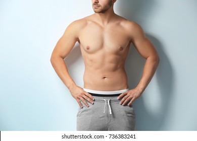 Sexy shirtless man on white background