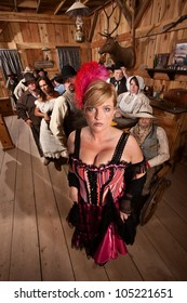 Sexy show girl shows off with large crowd in old west saloon