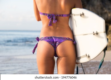 sexy silhouette surfer girl at sunset