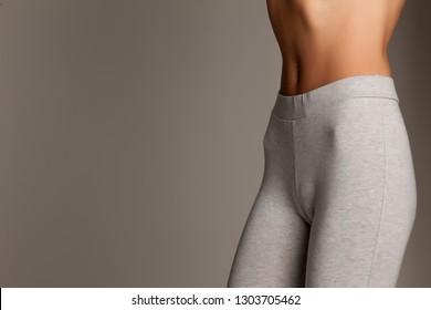 sexy slim female belly on white background