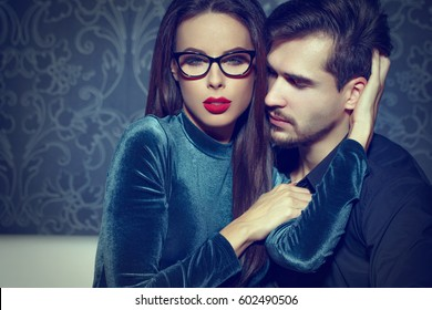 Sexy smart confident woman entice young rich man, playing with feelings, seduction