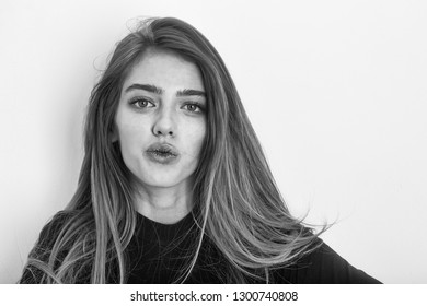 sexy smiling pretty girl or beautiful woman with long, blond hair, hairstyle, in black sweater has young happy face isolated on white background, copy space