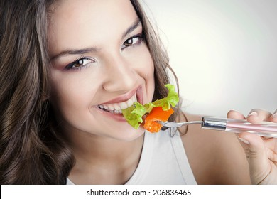 sexy smiling woman eating salad