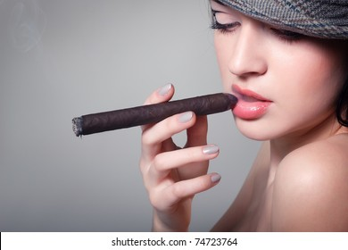 sexy smoking beautiful woman cigar closeup studio shot
