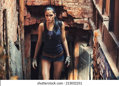 sexy soldier woman on factory ruins, action movie theme