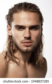 Sexy sport muscle strongface blond guy with long hair in white underwear on white isolated  font background