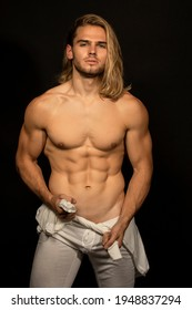 Sexy sport muscle strongface blond guy with long hair in white underwear on black isolated  font background