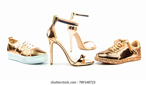 Sexy stiletto high heels with ankle strap and fashionable sneakers in shiny metallic color, isolated on white backgroud