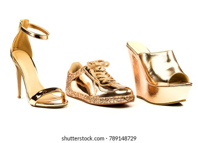 Sexy stiletto high heels with ankle strap, platform mules and fashionable sneakers in shiny metallic color, isolated on white backgroud