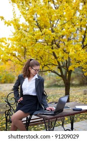 Sexy student girl with laptop outdoors