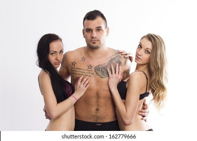 Sexy swinger trio on white isolated background