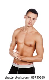 sexy tanned young man with naked torso naked, isolated over white