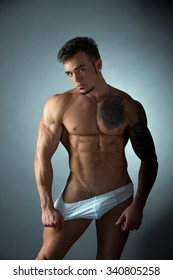 Sexy tattooed bodybuilder in provocative pose