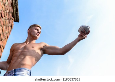 Sexy torso attractive waiter. Man muscular athlete bodybuilder offers you coffee. Strong muscles emphasize masculinity sexuality. Man muscular chest naked torso hold cup of coffee sky background.