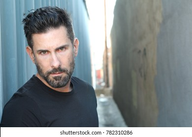 Sexy trendy man with a beard with copy space