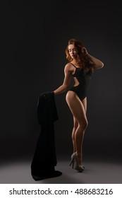 Sexy underwear model posing in high heels