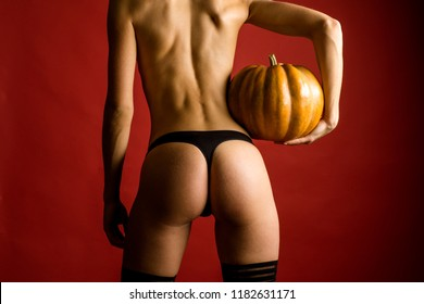 Sexy Vampire Woman buttocks. Female with sexy ass posing on pumpkin. Happy Halloween Sexy Witchs with Big sexy ass. Autumn time for Fashion sale. Erotic ladies Halloween concept