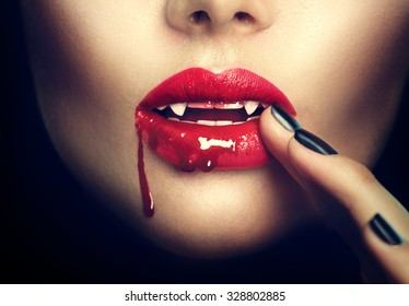 Sexy Vampire Woman lips with blood. Fashion Glamour Halloween art design. Dripping blood on mouth. Vampire makeup Fashion Art design.