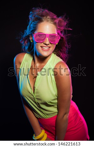 df9a536df5a Sexy vintage 80s fashion disco girl with long blonde hair and pink  sunglasses. Black background