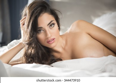 Sexy and voluptuous woman in bed