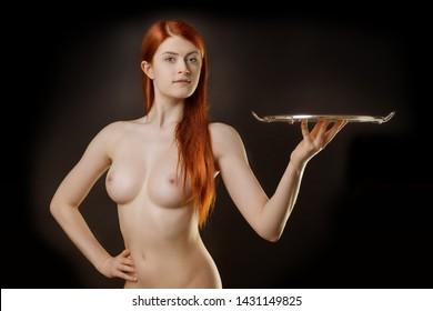 sexy waitress with an empty tray