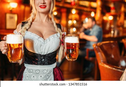Sexy waitress with large breasts in pub