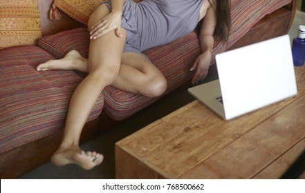 Sexy webcam girl posing on the sofa ready to strip for the customer