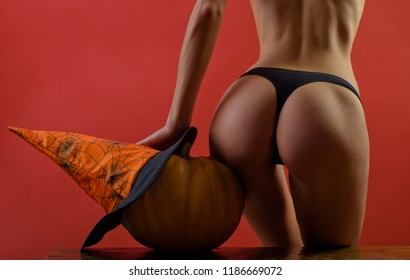 Sexy Witch vampire concept. Great ass and pumpkin. Advertisement concept. Sexy pumpkin butt. Halloween Party girls. Pumpkin head jack lantern. Trick or treat