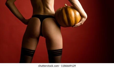 Sexy Witch vampire concept. Pumpkin head jack lantern. Carved Pumpkin - funny concept. Halloween sexy decoration and scary concept. Halloween background. 31 october