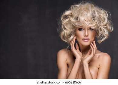 Sexy woman with amazing blond hair.
