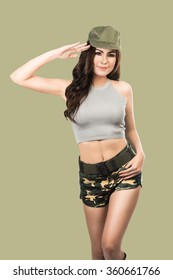 Sexy woman in army uniform saluting isolated with clipping path