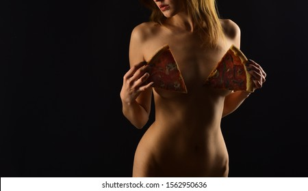 sexy woman with bare chest hidden with pizza slilces. censorship. Temptation. hunger and appetite. fitness deiting. healthy lifestyle. portrait of a sensual sexy girl. Fetish concept. Womens health.