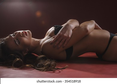 sexy woman in black erotic lingerie night on the floor