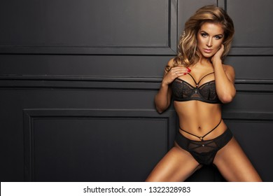 sexy woman in black lingerie in dark