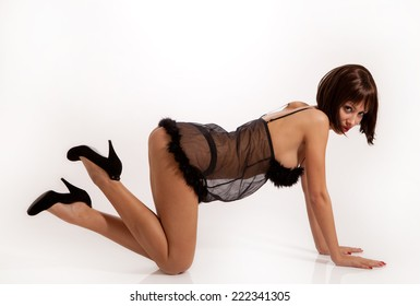 Sexy woman with black lingerie and high heels in doggy style position.
