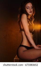 Sexy woman in black lingerie in studio