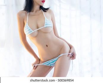 sexy woman in blue white streak bikini , big boods body parts