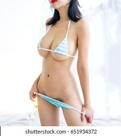 sexy woman in blue white streak bikini