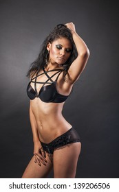 Sexy woman body. Erotic underwear isolated on a black background
