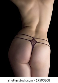 sexy woman body in string. Isolated on black background