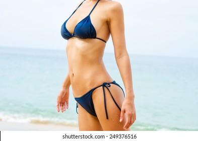 Sexy woman body in swimwear on the beach