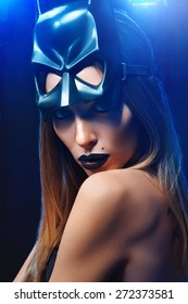 sexy woman in cat mask on a black