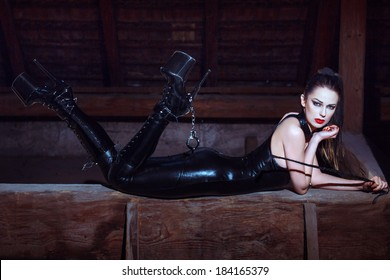 Sexy woman in catsuit and high heel platform boots, desire