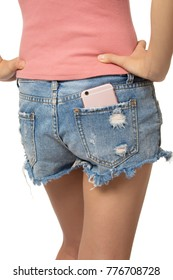 Sexy woman with a cell phone in her back pocket isolated on a white background