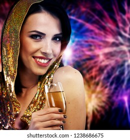 Sexy woman with champagne over fireworks background