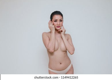 Sexy woman covers her breast. Nude body girl