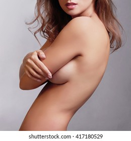 sexy woman covers her breast. perfect nude body girl