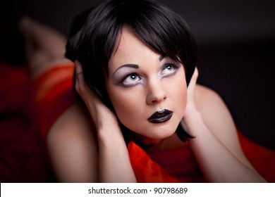 Sexy woman with creative makeup on black background