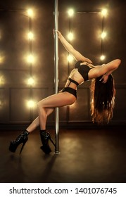 Sexy woman dance in studio. Pole dancer in studio background.